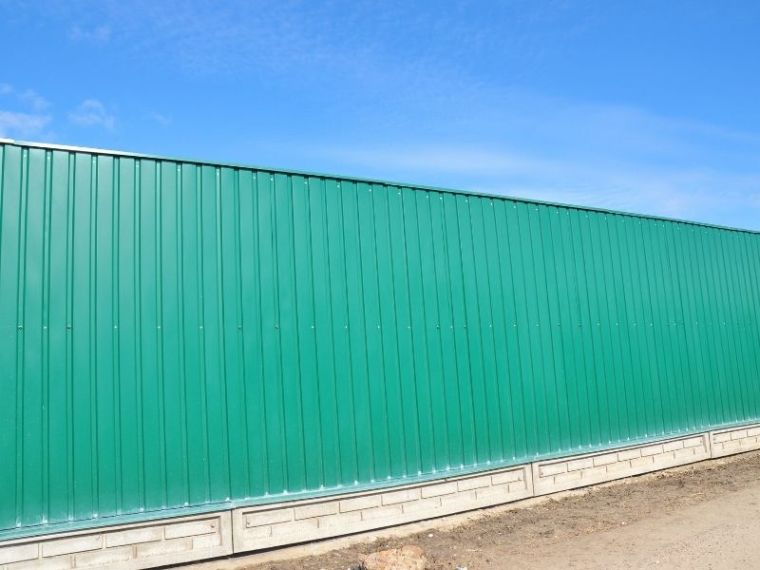 full stretch green colorbond fence